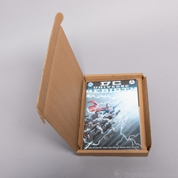Corrugated cradle for comic mailer